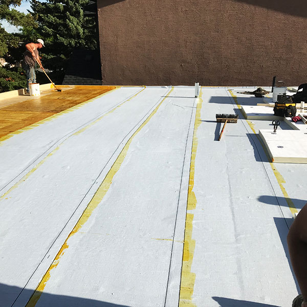 Applying Flat Commercial Roof coating